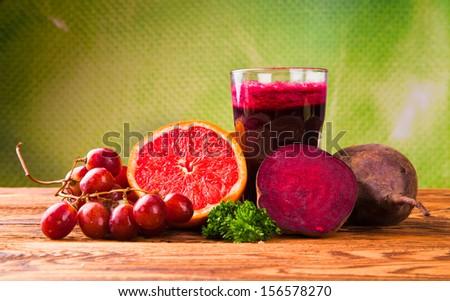 Beetroot juice,Healthy drink on wood - stock photo