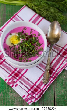 Beetroot soup. Holodnik. Cold soup made from beets, cucumbers, eggs, herbs and yoghurt. Traditional Lithuanian dish - stock photo