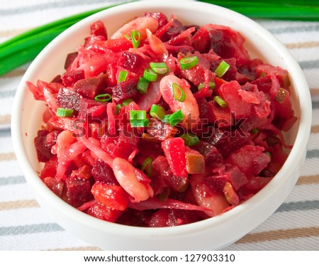 Beets, carrots, pickles, beans and onion salad known as Vinaigrette - stock photo