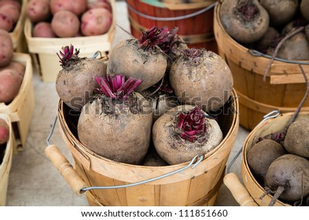 Beets in wooden baskets at market - stock photo