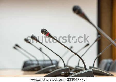 before a conference, the microphones in front of empty chairs.Selective focus.