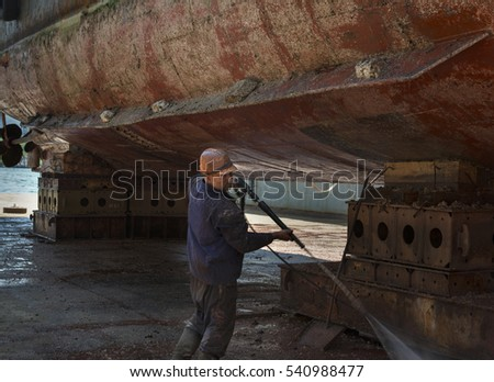 Before repairing a ship in a floating  dock, a  power  shower  wash