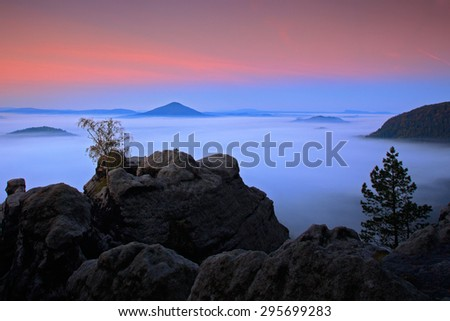 Before Sunrise in a beautiful mountain landscape of Czech-Saxony Switzerland.