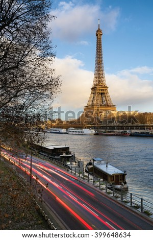 Before sunset at the Eiffel Tower along the Seine River in Paris, France (7th arrondissement) - stock photo
