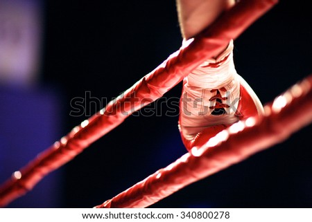 Before the fight start, hand of a boxer at the ring - stock photo