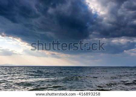 Before the storm. Dark moody sky over the gray sea - stock photo