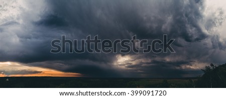 Before the storm on the meadow. Stormy sky over the valley. Dramatic sky before thunderstorm. Landscape of valley. In the lower left corner there is monastery. Large, high resolution panoramic photo.