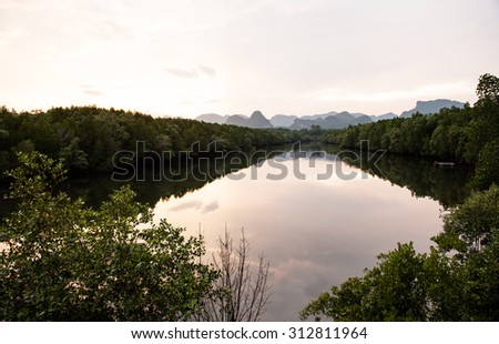 Before the sunset at the mangrove forest along the river to the end of view at the mountain  - stock photo