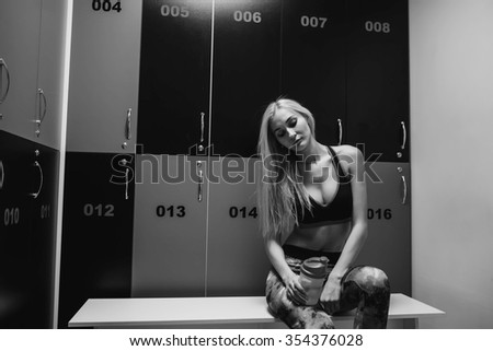 Before training. Girl in a gym locker room