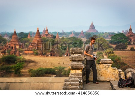 Began, Myanmar - March 15th 2016 - Tourist observing the amazing sunrise in the temples of Bagan in Myanmar. Asia.