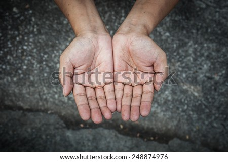 Beggar and poverty concept - person hands begging for food or help