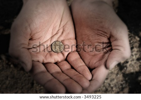 Beggar hands, slightly desaturated and blurred on edges. - stock photo
