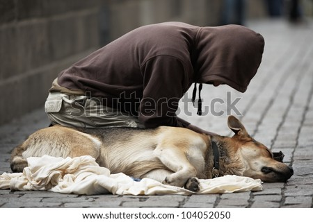 Beggar with dog on the street of Prague, Czech Republic - stock photo