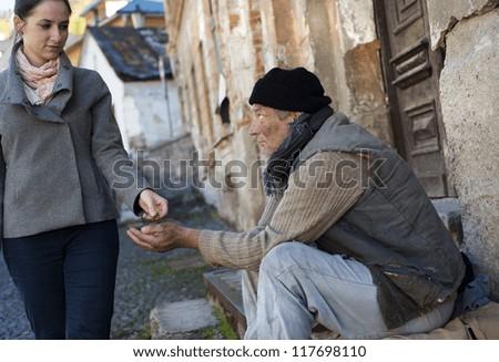 Begging man on the street - stock photo