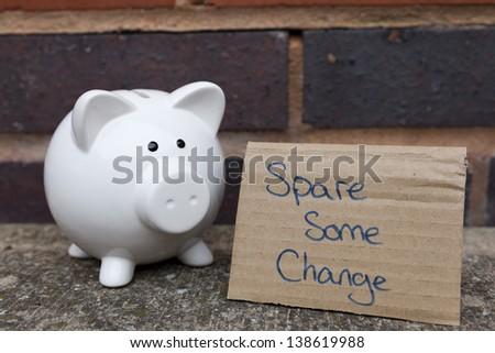 Begging piggy bank concept - stock photo