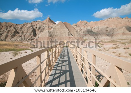 Beginning of Saddle Pass Trail in the Badlands National Park, South Dakota. - stock photo