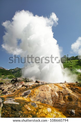 "beginning of the eruption of a geyser ""Velikan"" (Giant) in the Valley of Geysers, Kamchatka. Velikan (Giant) largest and most beautiful Kamchatka geyser"