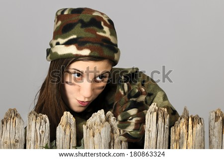 Behind a Fence in Camo - stock photo