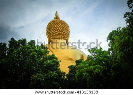 Behind Buddha statue in Thailand - stock photo