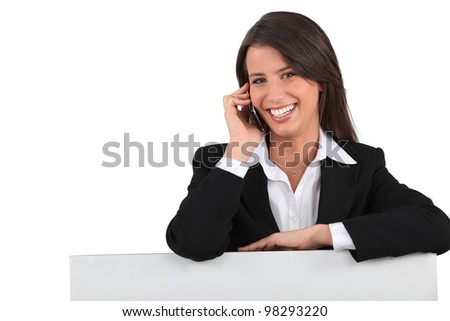 Behind the counter with the mobile - stock photo