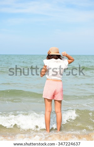 Behind the girl in action in the sea