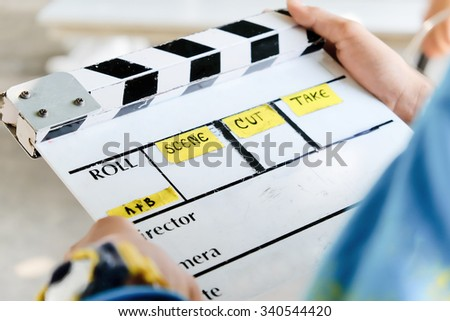 behind the scene,film slate and film crew production set - stock photo