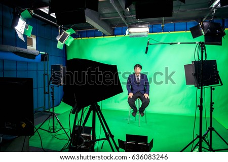 lighting set. behind the scenes of tv movie video film shooting production crew team and camera lighting set