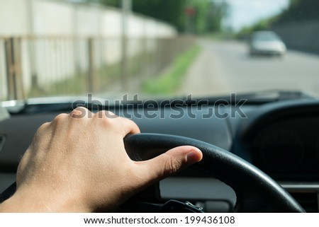 Behind the wheel of a car - stock photo