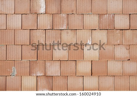 beige brick wall as background