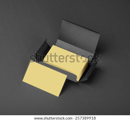 Beige business cards in the gray box - stock photo