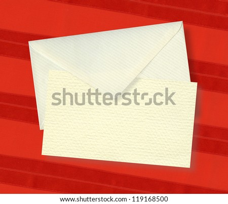 Beige card and envelope with shadow on red
