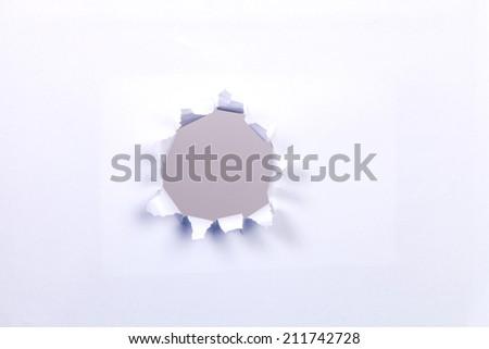 Beige circle shape breakthrough paper hole - stock photo