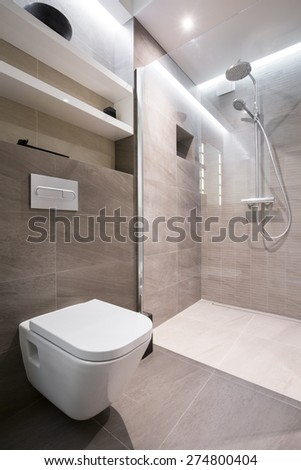 Beige clean toilet interior in modern house - stock photo