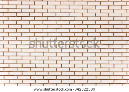 Beige colored fine brick wall texture background, large detailed horizontal textured closeup pattern - stock photo