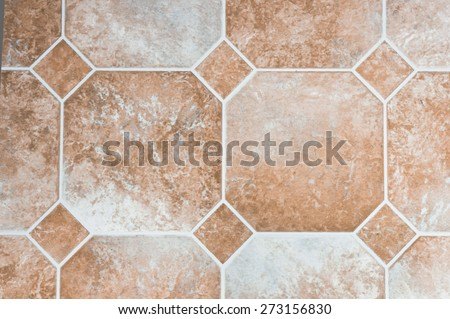 Beige colored vinyl tiles on a kitchen floor - stock photo