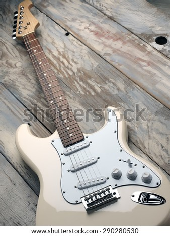 Beige electric guitar on a wooden vintage background - stock photo