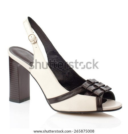 Beige high heel shoe isolated on white background.