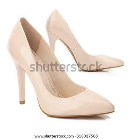 Beige high heel shoes isolated on white. - stock photo