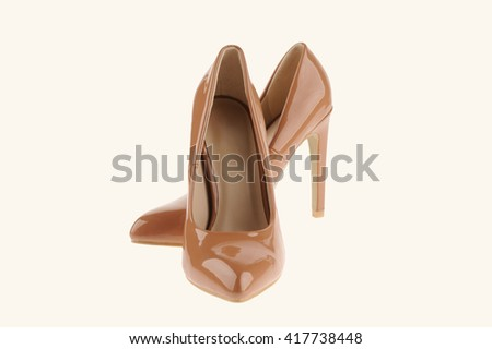 beige high heel women shoes isolated on white background - stock photo