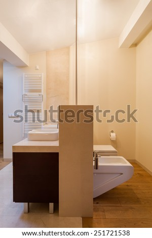 Beige interior of bathroom in residence - stock photo