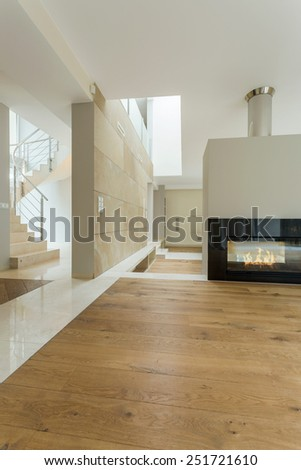 Beige interior of modern and spacious house - stock photo