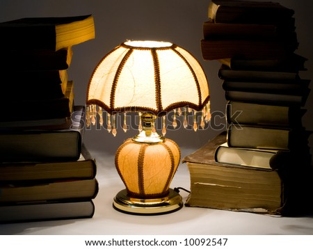 beige lamp on white background isolated with books - stock photo