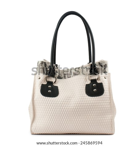 Beige leather handbag with black handles isolated on white.