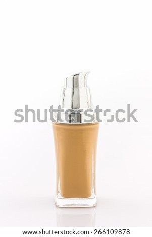 Beige make up foundation in luxurious bottle on white background.