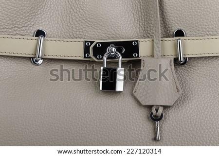 Beige natural leather female purse closeup - stock photo