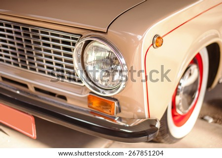 Beige old russian restored car, side view. - stock photo