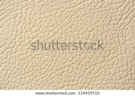 Beige Patterned Artificial Leather Background Texture - stock photo