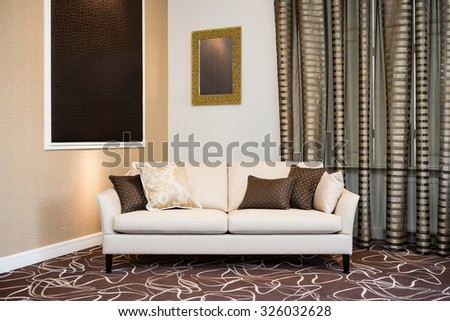 Beige sofa in luxurious living room - stock photo