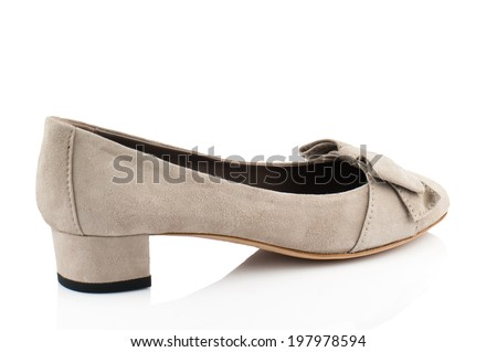 Beige suede  women shoe isolated on white background. - stock photo