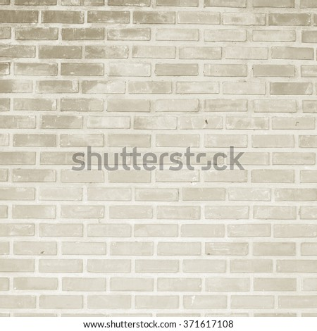 beige tan color of bricks cement wallpaper background textured:modern sepia brickwork concrete wall:stucco backdrop interior.rough and grain stone wallpaper concept.cropped frame display picture. - stock photo
